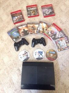 PS3 with games and controllers London Ontario image 1