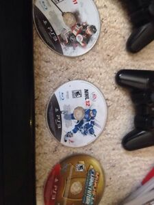 PS3 with games and controllers London Ontario image 3