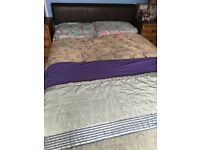 Double bed. Leather upholstered.