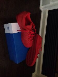 Drenched in red Adidas Superstars