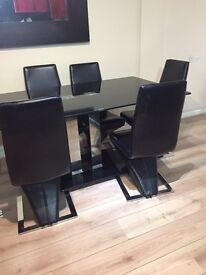 Black frosted glass dining table with 6 chairs
