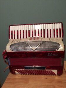 Silver tone piano accordian