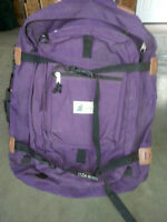 Suitcase backpack with zip off daypack