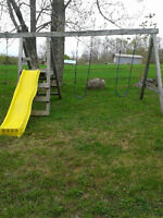 Wooden swing set and plastic sand box