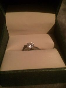 14K white gold solitaire engagement ring. Weight 1.01ct