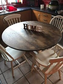 Round drop leaf table with 4 off white chairs