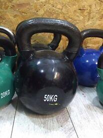 Brand new cast iron vinyl dipped 50kg kettlebells