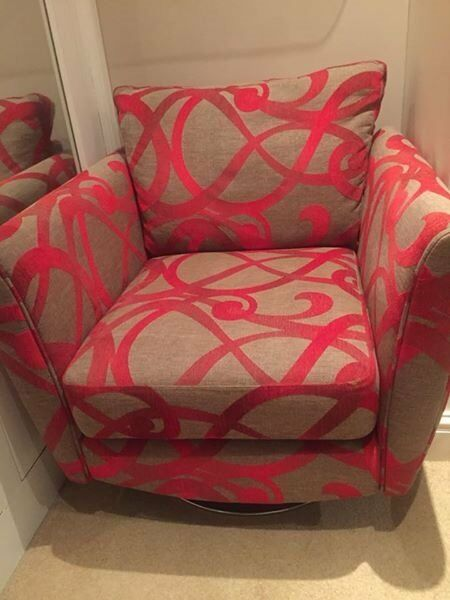 DFS Red patterned armchair on swivel base - barely used