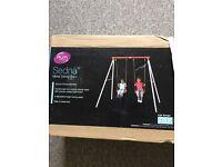 Brand new plum double swing set