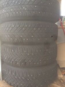 4 studded Goodyear Winter Ultra grip tires and rims 225/65R17