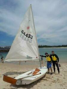 Laser sailing boat on registered trailer, ready to sail