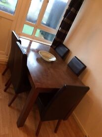 Solid wood 6 seater table with chairs
