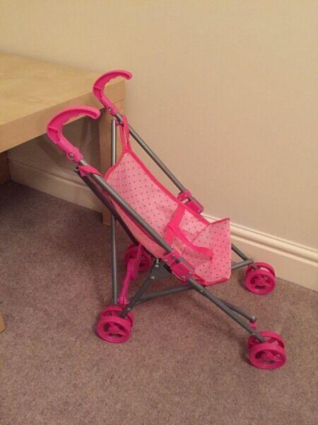 Child's pink push chair pram toy