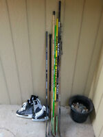 Assorted sticks and 2 pairs of skates - $30 obo