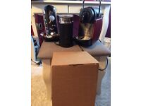 Coffee machine, milk frother coffee display stand as well as a whole box of flavoured coffees