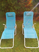 Two reclining lawn chairs