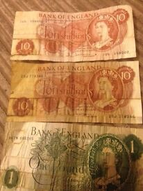 Two ten shilling notes and one , one pound note