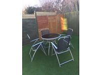 Black glass Garden Table, 4 chairs and Umbrella