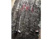 Set of golf clubs bag wedges and putter