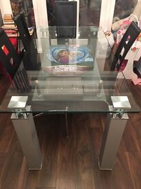 Glass dining table plus 5 chairs