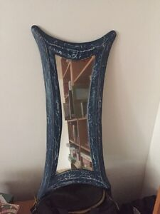 Unique blue framed mirror