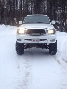 Lifted Tacoma trd supercharger