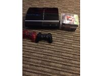 PlayStation 3 40gb with 2 controllers and 7 games