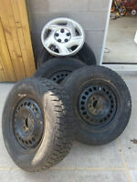 Set of 4!  215/70/r15 winter tires and rims.  5x115