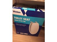 Brand new toilet seat. White Mixed wood with tongue and grooving style no longer needed