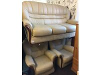 Cream Leather settee with two chairs. Sofa, living room, suite.