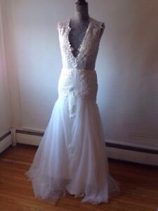 Wedding dress for $300 never been used!