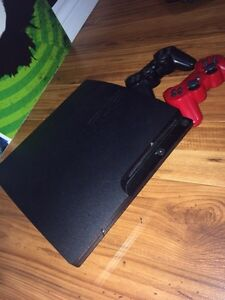 Sony PlayStation 3, 2 controllers, charging pad, 13 games St. John's Newfoundland image 1