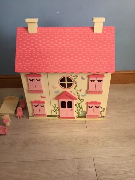 Children's dolls house with furniture