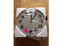 Stainless stell wall clock with spaces to all photos