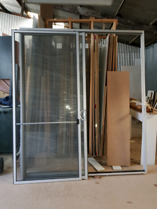 Brand new natural silver sliding door with screen and lock Woodville Park Charles Sturt Area Preview