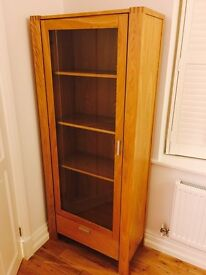 A Solid oak bookcase with drawer