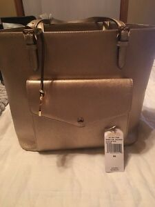 MICHEAL KORS GOLD LARGE PURSE with tags