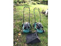 2 petrol lawnmowers