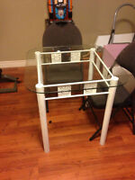 Glass table with white metal frame