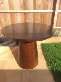 Wood made circle table used indoors