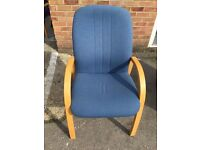 Blue visitor chair with wooden frame