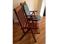 2 wooden folding garden chairs and seat pads