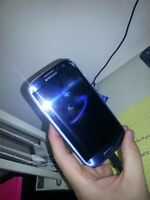 BLUE SAMSUNG GALAXY S3 WITH CHARGER AND 16 GB MEMORY - FIDO