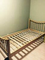 IKEA wooden single bed frame. $80. Airdrie.