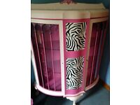 Funky pink bow front display cabinet