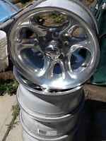 "FOUR 15"" EAGLE ALLOY RIMS"
