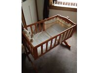 Swinging crib and Moses basket