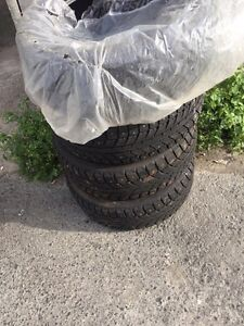 4 new studded winter tires 205/55/16