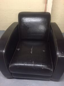 Leather sofa with its puffy chair