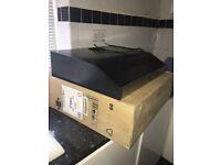 New in box extractor hood